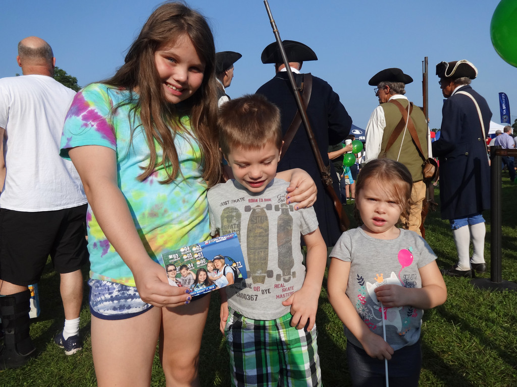 . Annabelle Meaney, 10, Zachery Kane, 5, and Olivia Kane, 3, all of Billerica, displayed a photo they had taken at a booth. Photo by Mary Leach