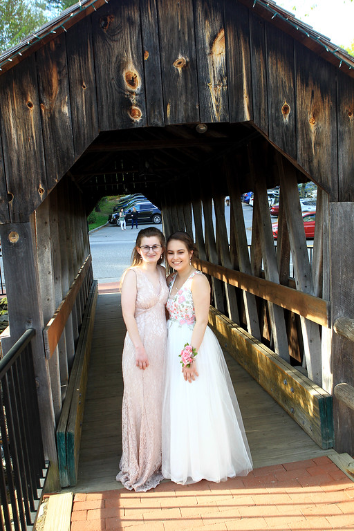 . Lily Kopsala and Samantha Jean at pose at the covered bridge just before the Sizer School prom held Saturday at Westminster\'s 1761 Old Mill. Photo by Vincent Apollonio