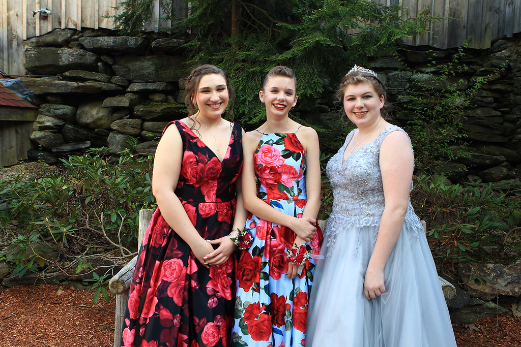 . Grace Vartanian ,and Corinne and Keny Breen share at moment before the Sizer School prom held Saturday at Westminster\'s 1761 Old Mill. Photo by Vincent Apollonio