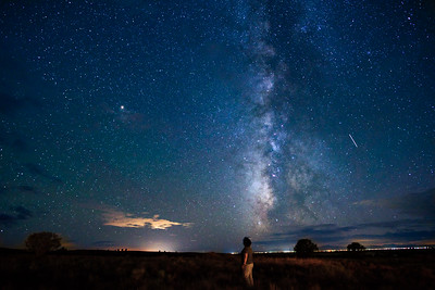 Joshua Birndorf 10/10/2018 Colorado College anthropology and archaeology students venture to the San Luis Valley to conduct field survey with the United States Forest Service and look for evidence of the Old Spanish Trail. The stars are clear as day at the Baca campus. Here, Ella Axelrod gazes up at the milky way.