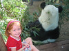 Elizabeth sitting next to the giant panda.  He was eating lunch.
