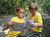 Jackson with his best friend Nick.  They are reading the zoo map together and deciding where to go next.