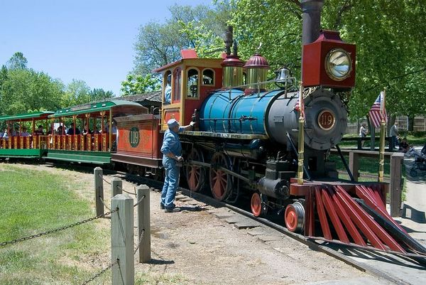 """<font size=""""3"""">The zoo is quite large. Some visitors ride the train.</font>"""