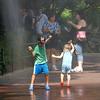 Two humans, wet. National Zoo, Washington, DC