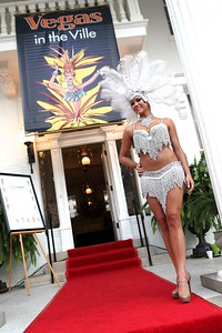 Showgirl Kym Decker greeted arriving guests on the porch of Whitehall House and Gardens.
