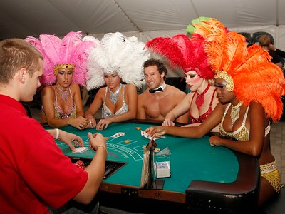 Vegas in the Ville Showgirls and Scott Maymon sit down for a round of blackjack.