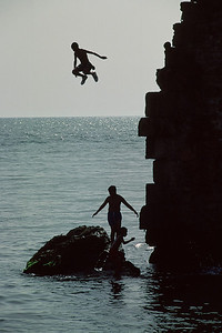 Boys jump in the water from cliffs in the Akko port area. January 09, 2006. Photo by Doron Horowitz