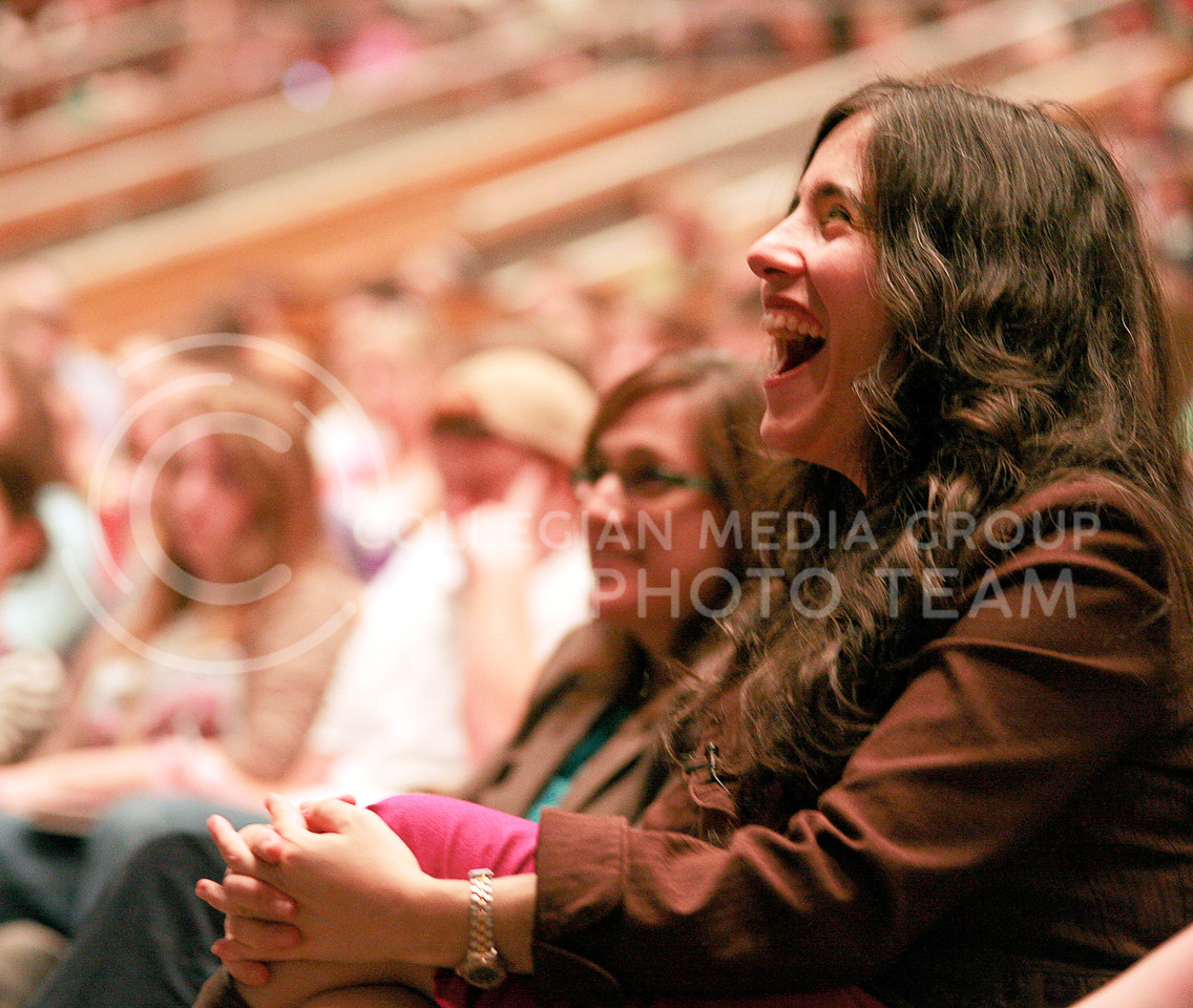 "Jennifer Pozner, a journalist and media critic, laughs during her lecture ""Project Brainwash: Why Reality TV is Bad for Women (...and men, people of color, the economy, love, sex and sheer common sense)"" as Gregory Eiselein, English professor, flaunts Pozner's enthusiasm for tweeting. He encouraged attendees to tweet their reactions to the lecture because Pozner was named in Forbes magazine as one of ""20 Inspiring Women to Follow on Twitter."""