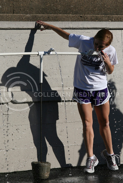 Megan Quigley, senior in fine arts, takes a drink during a break from a Classy Cat's practice in Memorial Stadium, Oct. 28.