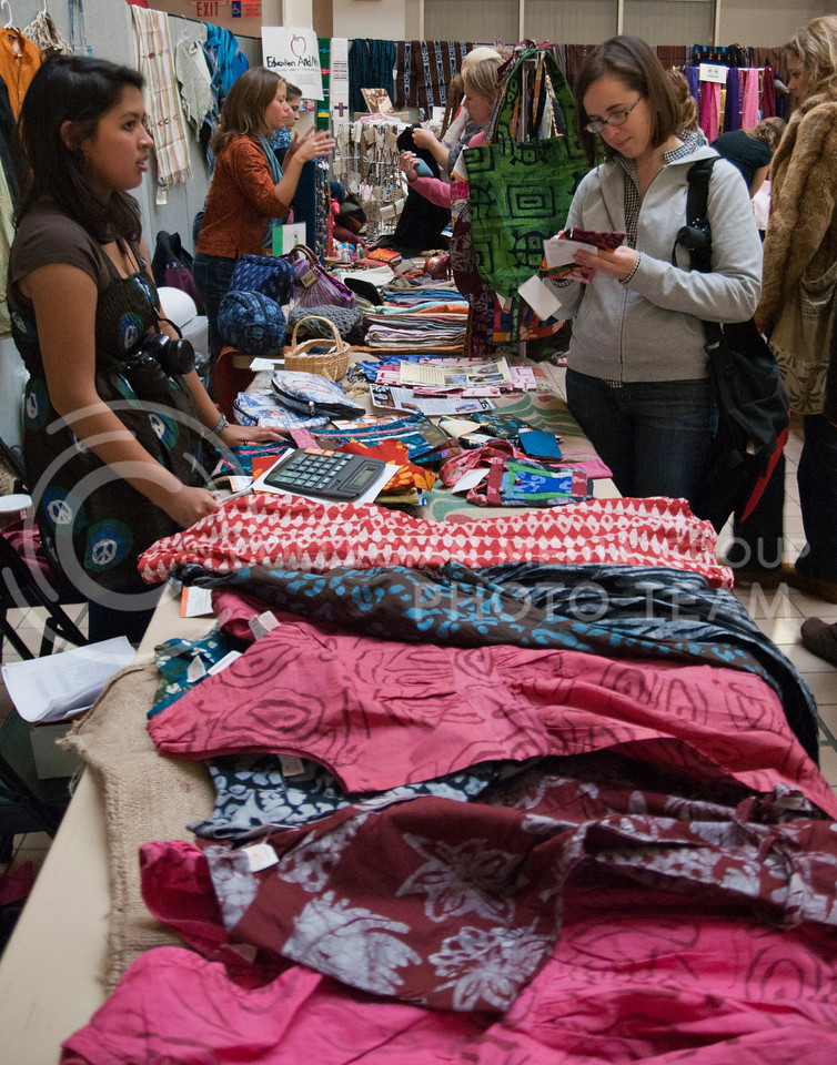 Isabel Troncoso (left), junior in sociology watches as customers browse the Fair Trade Market Wednesday afternoon in the K-State Student Union courtyard.