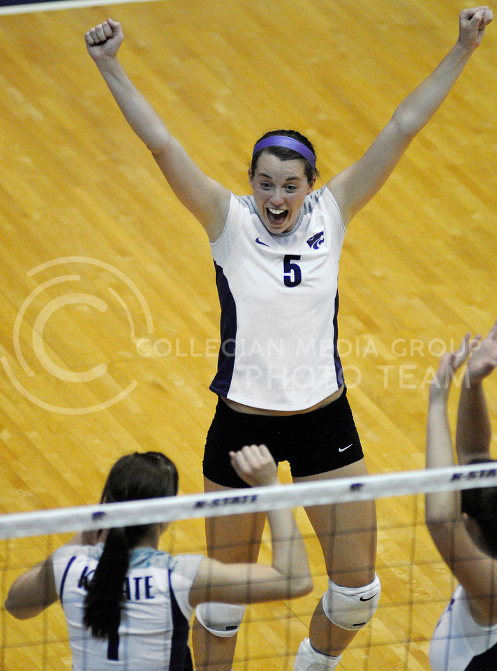 Kathleen Ludwig, sophomore opposite hitter, celebrates a point against KU in K-State's matchup against the Jayhawks Wednesday evening in Ahearn Fieldhouse. Kansas State won the match.