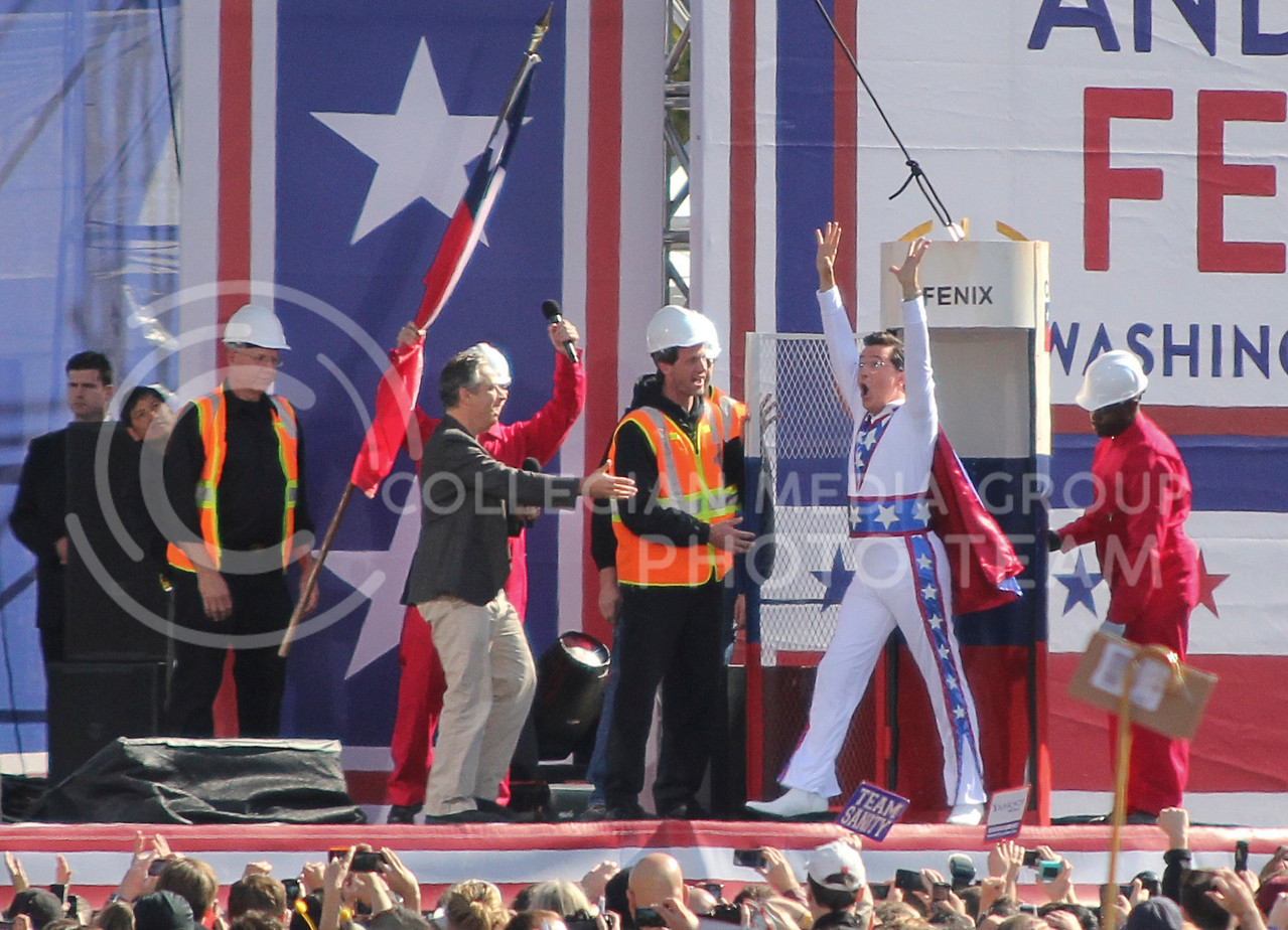 """Steven Colbert emerges from his """"fear bunker"""" in an Evil Knievel jumpsuit to a crowd of more than 250,000 people in Washington, D.C., Saturday."""