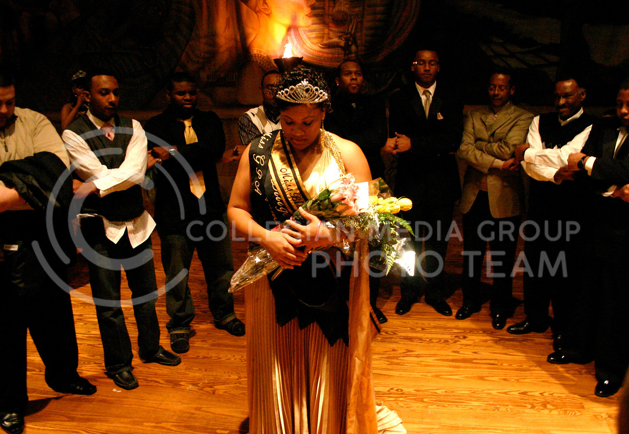 Members of the Alpha Phi Alpha Fraternity Inc. serenade Toni Owens, winner of the Miss Black and Gold Pageant, Saturday evening after Owens was crowned Miss Black and Gold 2008-2009. Owens was one of the eleven women who participated in the competition.