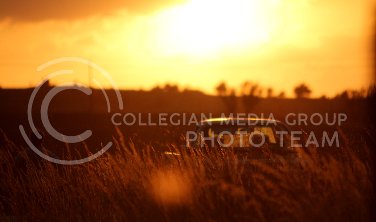 A hiker at the Konza Prairie admires the setting sun on Tuesday, Oct. 12th.