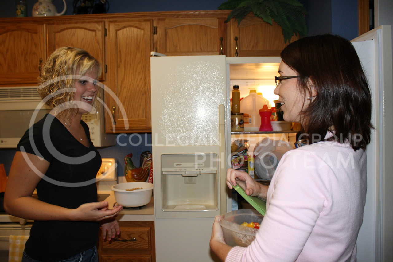 Shannon Underwood, graduate student in business administration, discusses dinner plans with Kati Jackson, right, one of her clients. Underwood owns a business that offers recipe advice, grocery shopping consultation and home-cooked meals to local families.