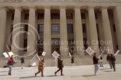 GEO members and supporters picket in front of Angel Hall on Monday, April 8, 1996.  GEO was in the first day of their two-day walkout which they staged to better their position in bargaining talks with the University for a new contract.
