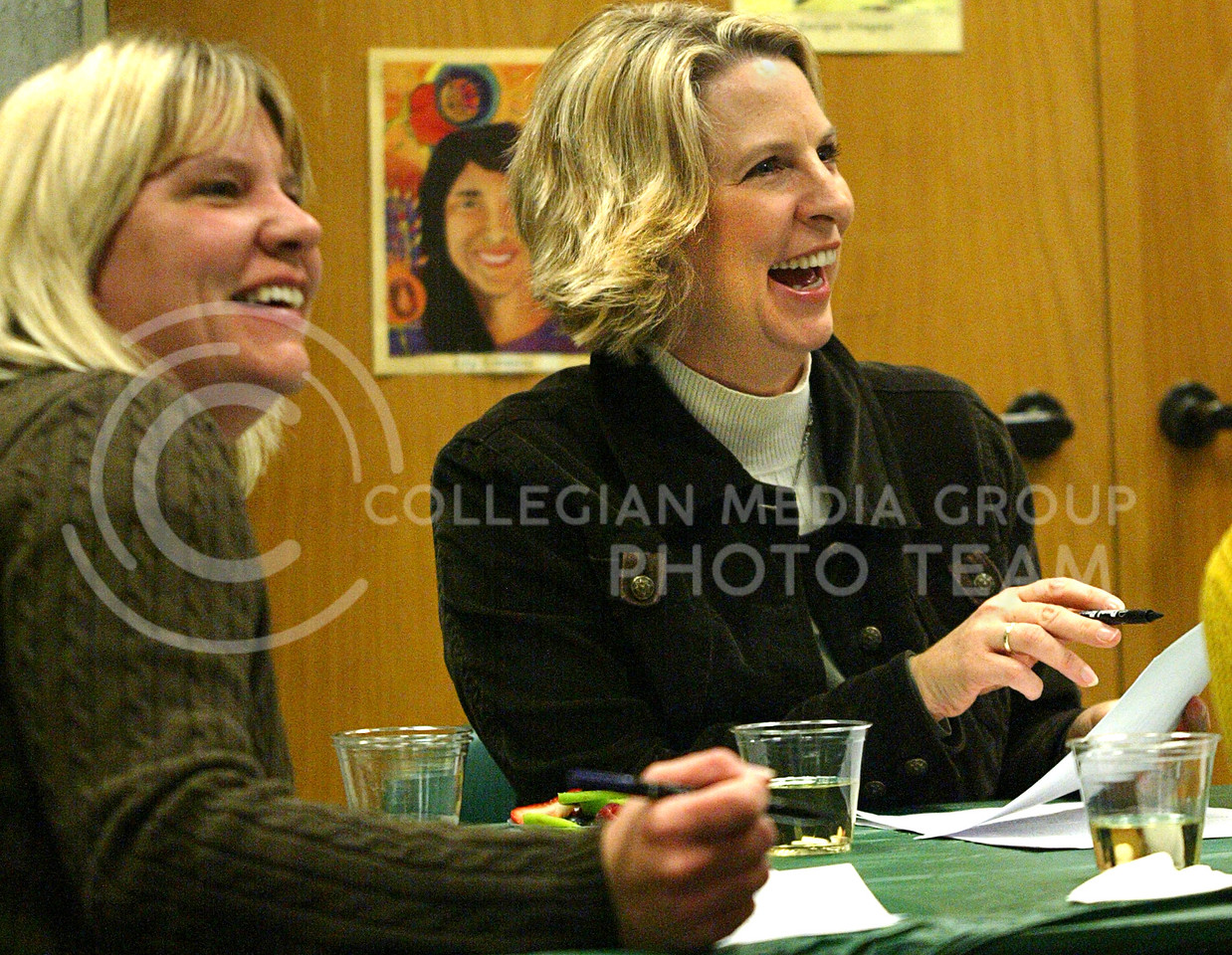 Lee Ladner (right), a Manhattan resident, and Pam Martinez (left), accountant for the institute of environmental research, laugh Thursday night while practicing sumi-e.