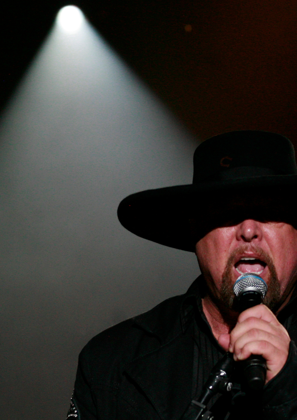 Country Music Award-winning band Montgomery Gentry performs at Stampede Saturday night. Eddie Gentry donned his signature hat and sang old and new songs for the crowd.