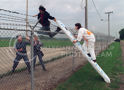Anti-Nuclear protesters scramble over a fence into the arms of security officers at the Fermi II Nuclear Power Plant in Monroe, Michigan.  The protesters were arrested.
