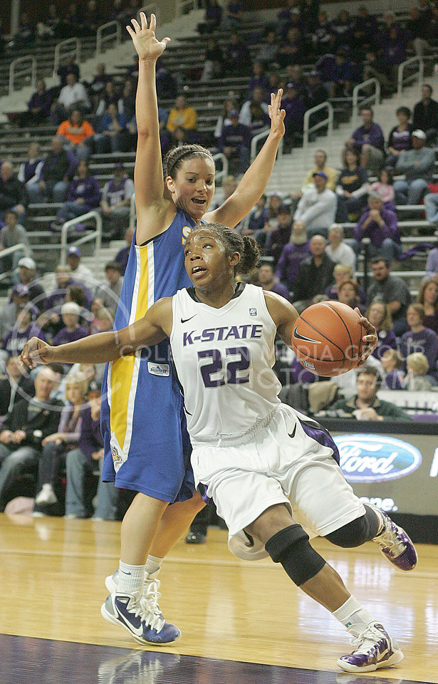 K-State guard Mariah White (22) drives the lane during the first half against South Dakota State in Bramlage Coliseum Tuesday, November 30, 2010. Kansas State defeated the Jackrabbits, 56-51.  (Jonathan Knight/Kansas State Collegian)