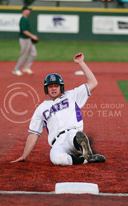Junior shortstop Carter Jurica dives to safely take third base in the game against Chicago State on Tuesday in Tointon Family Stadium.