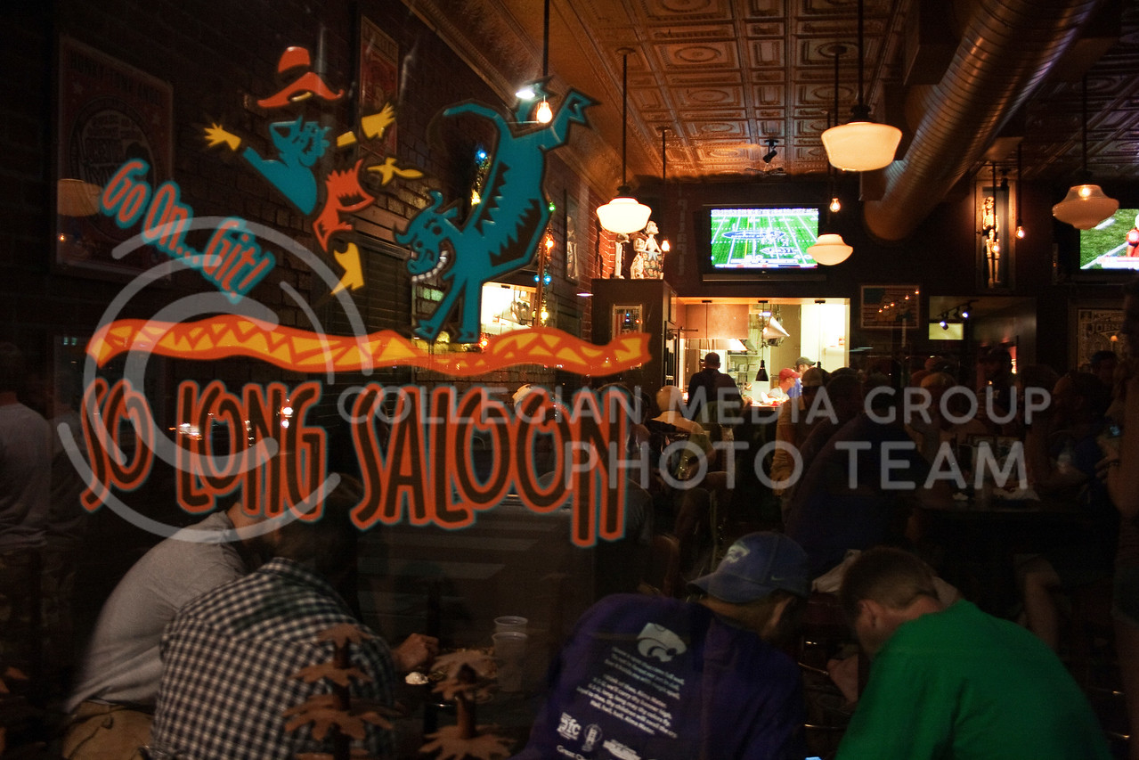 After the Wildcats defeated the UCLA Bruins in football on Sept. 4, So Long Saloon, located in Aggieville, was packed with fans wanting something to eat and to watch the other games on television.