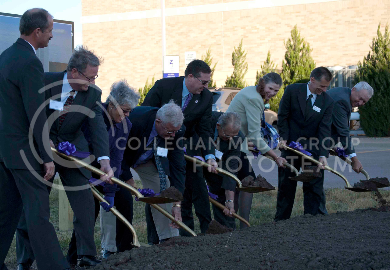 K-State President Kirk Schulz and Provost April Mason along with other K-State faculty break ground on the need feed mill for the Department of Grain Science and Industry Saturday evening.