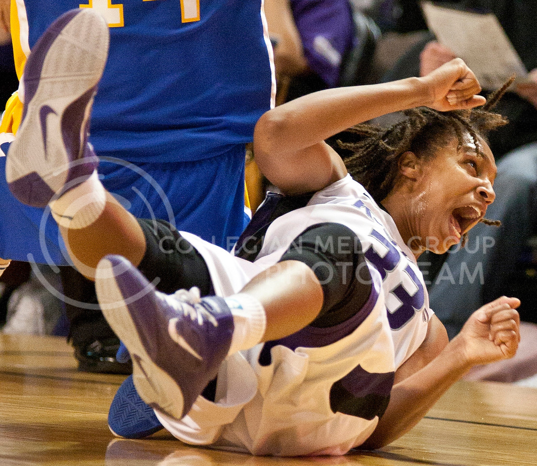 The KSU Women's game was a fierce battle which ended in a hard earned win. The Wildcats came back from a six point deficit in the first to win by five in the second. Shalin Spani screams  after lunching for a displaced ball at Tuesdays game in Bramledge Coliseum .