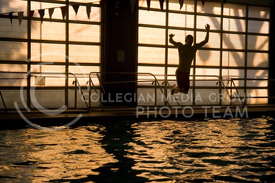 Reid Carlson, a junior from Clay Center Community High School, jumps into the pool at Ahearn Field House's Natatorium after Manhattan High School's swim team practice Thursday. Carlson, the only state qualifier for MHS, participates on the Manhattan High team because CCCHS does not have a swim team.