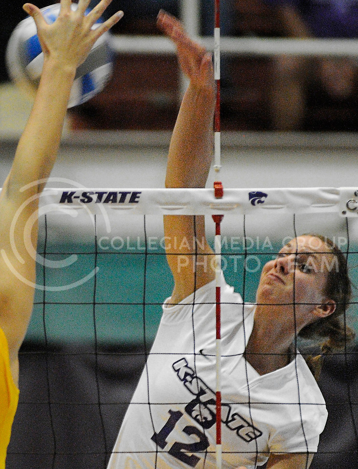 Julianne Chisolm, outside hitter, spikes the ball toward the UMKC Roo's Tuesday evening in Ahearn Field House.