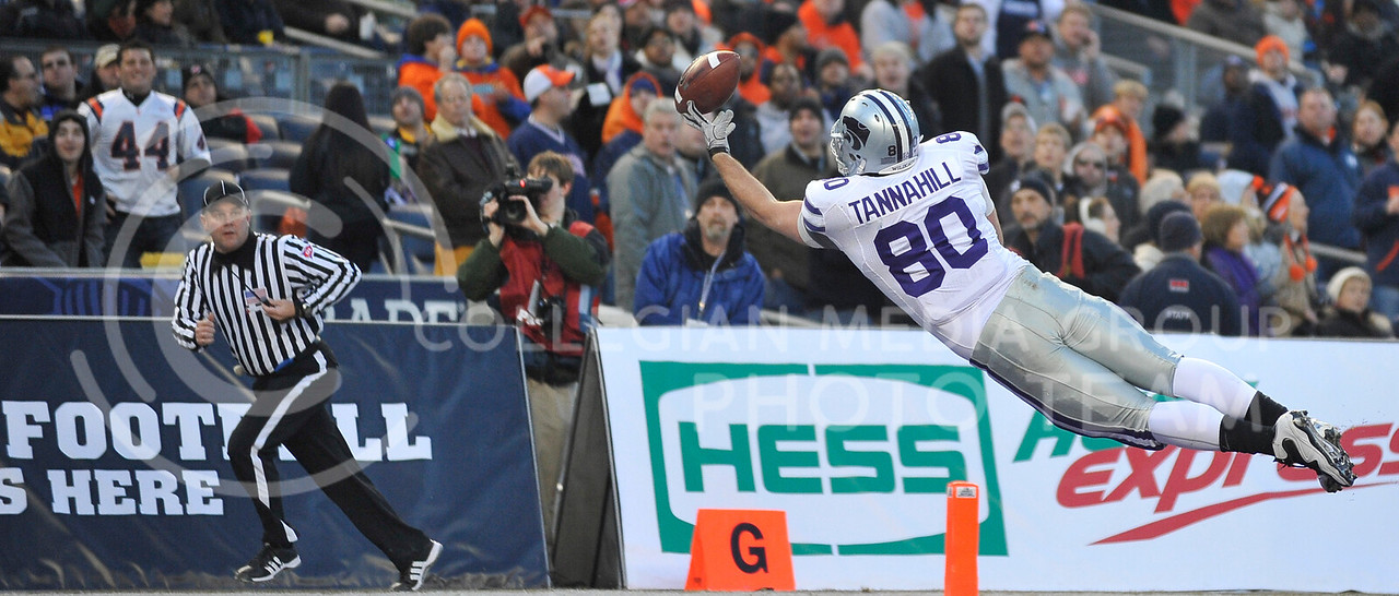 Travis Tannahill (80), tight end, stretches out to try and catch a pass during the first half of the New Era Pinstripe Bowl Thursday evening. K-State lost to Syracuse 34 to 36 in the last few minutes of the game.