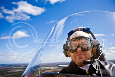 Jim Clark, pilot, gave air rides during an antique air show in Junction City Kansas October 3, 2009 in his 1928 open cockpit biplane to raise money for the local Experimental Aircraft Association chapter.