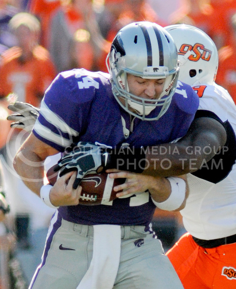 Carson Coffman, K-State quarterback, gets tackled by Oklahoma State defensive end Richetti Jones during the football faceoff between the Wildcats and the Cowboys Saturday afternoon at Bill Snyder Family Stadium. Coffman had -1 rushing yards for the day.