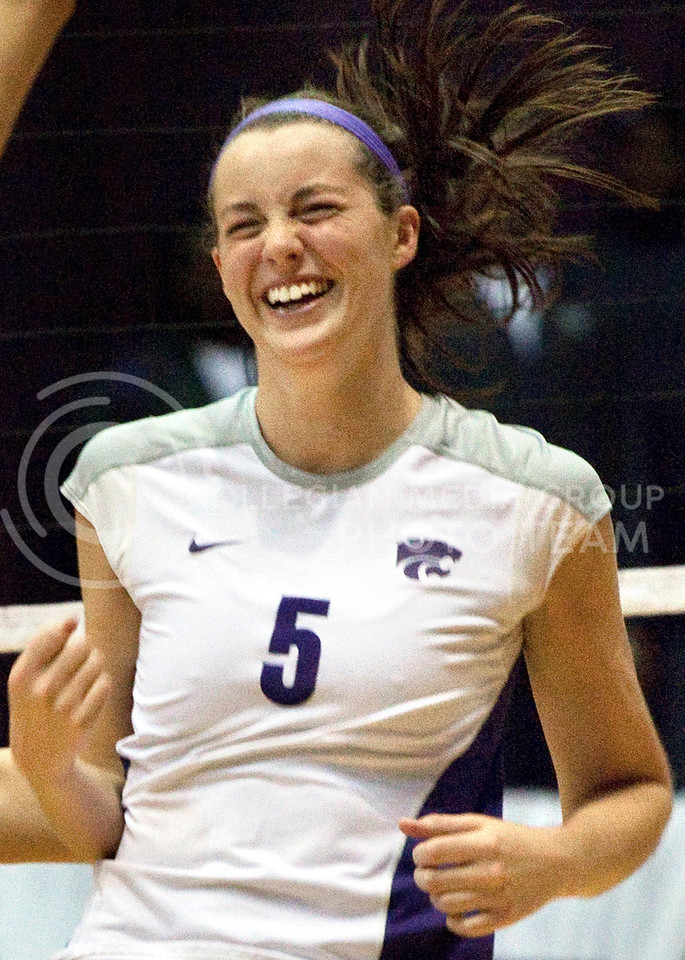 Members of the K-State volleyball team celebrate after scoring a point Saturday night against Texas at Ahearn Fieldhouse.