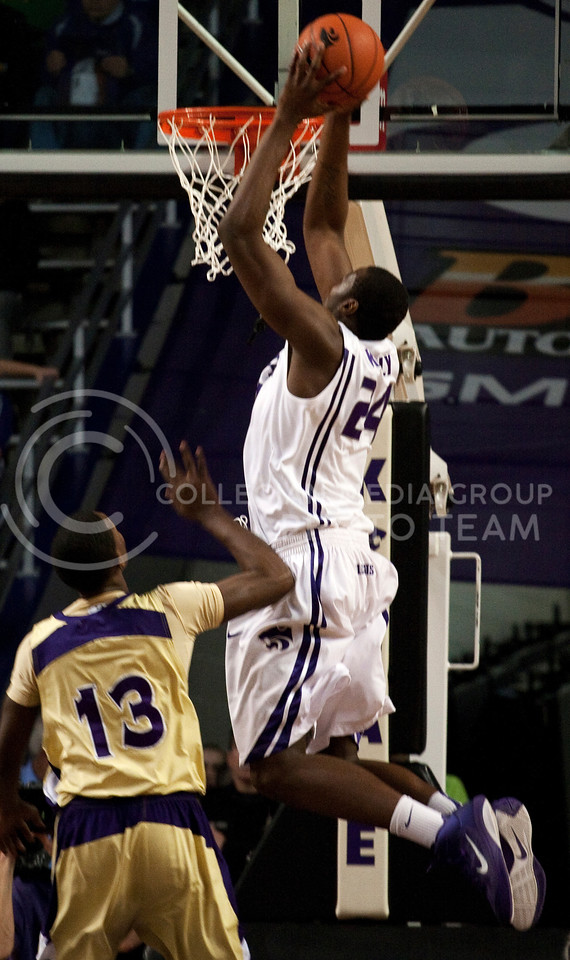 Senior forward, Curtis Kelly, throws down an emphatic dunk off of a lob pass in the first half against Alcorn State on Monday.