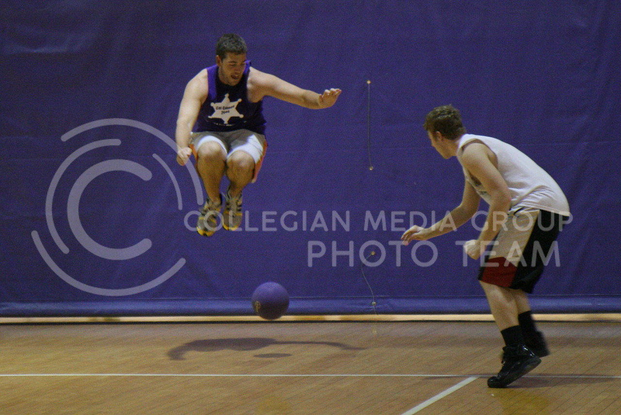 """Drew Tenbrink, senior in Finance & Accounting, leaps into the air to avoid a deadly dodgeball. """"[Dodgeball] is a good way to relieve stress,"""" Tenbrink said. """"And it's a good exercise for a big guy like me."""""""