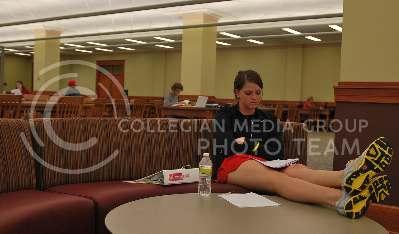 Candice Edwards, sophomore in business sits in Hale Library studying for her management class Monday afternoon.