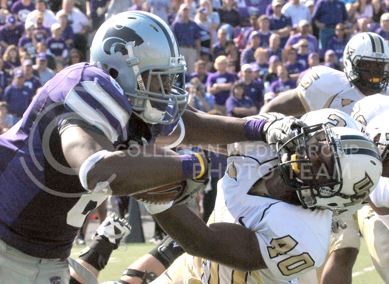 Running back Daniel Thomas slams into a University of Central Florida player while running down the field at Bill Snyder Family Stadium on Saturday afternoon. K-State won the game 17-13.