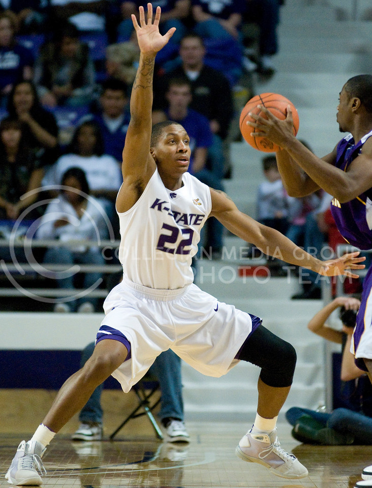 Rodney McGruder, guard, raises his hand high to block a potential pass during the K-State vs West Illinois basketball game last fall. McGruder returns to the Wildcat lineup this year as a sophomore after playing 33 games his freshman year.