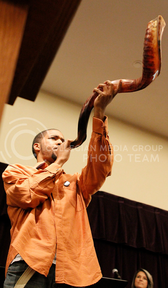 Jahvelle Rhone, worshorper at Manhattan Christian Fellowship Church, blows on a Shofar used in a solom assembly when calling believers together for one purpose on Wednesday night in the Union Ballroom.
