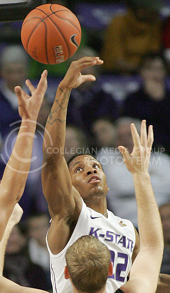 K-State guard Rodney McGruder (22) and K-State forward Freddy Asprilla (15) try and secure a rebound over Emporia State forward Adam Holthaus (50) during the first half against Emporia State in Bramlage Coliseum Monday, November 29, 2010. Kansas State defeated the Hornets, 85-61.  (Jonathan Knight/Kansas State Collegian)