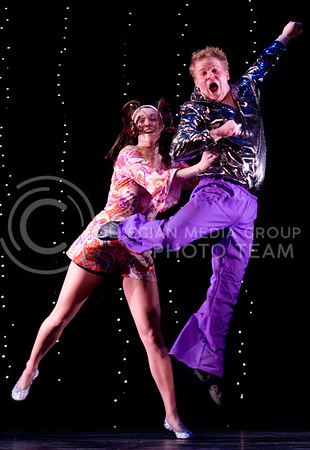 Sophomore volleyball player Kathleen Ludwig tosses her partner, Kyle Landau, senior in marketing, accounting and finance, during their preformance at Dancing with the K-State Stars Thrusday night in McCain Auditorium. Ludwig and Landau placed first in this years competition.
