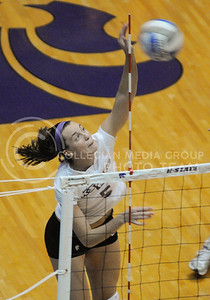 Junior Kathleen Ludwig spikes the volleyball during the match against Texas Tech Nov. 3 in Ahearn Fieldhouse.