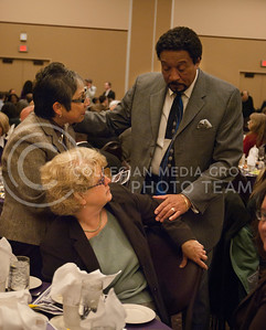 Susana Valdovinos, director of academic personel, Pam Foster, associate director of affermative action office and David Griffin, assistant dean of diversity chat before the speech during the Dr. Martin Luther King, Jr. Fellowship Luncheon in the Alumni Center ballrooom Thursday afternoon.