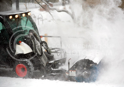 The Kansas State Facilites crew pulled out their snow equipment to augment to their bobcat Toolcat with an angle broom to clean snow from the the sidewalk adjacent to the Union without causing damage to the surfaces.