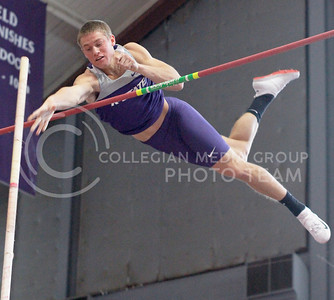 Freshman jumper Kyle Wait, releases his pole as he stretches over the bar on Saturday in Ahearn Fieldhouse. Wait placed first in the pole vaulting event.