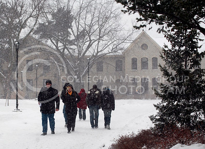 Students make their way thru the campus during the snow storm Wednesday afternoon.