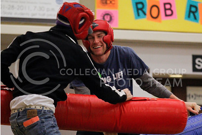 Brad Craemer, senior in life sciences, laughs while trying to avoid getting hit during a battle with friend at the UPC Winter Activities Carnival on Thursday night in the Union.