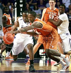 Martavious Irving chases down a ball from J'Covan Brown. Irving had 2 steals in Thursday's 84-80 victory against Texas at Bramlage.