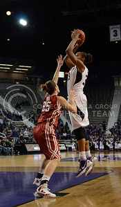 Jalana Childs, senior forward, jumps to make a basket during the second half of the OU game Jan. 17 in Bramlage.